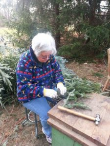 Bruce's wife Jeanne, handcrafting a Fraser fir wreath.