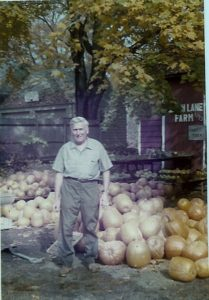 Herb by the farmstand in 1974.