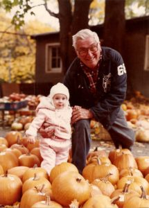 Herb with his first granddaughter Abigail in 1981.
