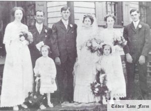 The wedding of Leroy Tilden to Daisy Gardiner (center) on September 20, 1911, which took place at the William Gardiner farm, Daisy's childhood home. On their left are Charles Gardiner and his fiancee Ethel Burt; Florence James and Leroy's brother Raymond are on the right. The twin girls in front are Ella and Elsie, Daisy's little sisters.