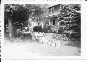 This 1930s photo shows a self-service wagon set up with farm produce outside Roy and Daisy's home on Greenlawn Rd.