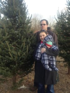 Logan with his Mom (Herb's granddaughter) Rebecca and Dad Mike, picking out his very first Christmas tree.