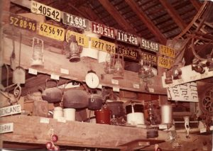 This snapshot of the interior of the barn is undated but was likely taken in the 1960s. The collection of license plates dating back to 1915, along with many antiques and Uncle Everett's arrowhead display, was a familiar sight to the farmstand's many customers.